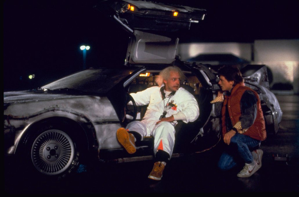 "Christopher Lloyd, left, as inventor Doc Brown and Michael J. Fox as Marty McFly in ""Back to the Future."""