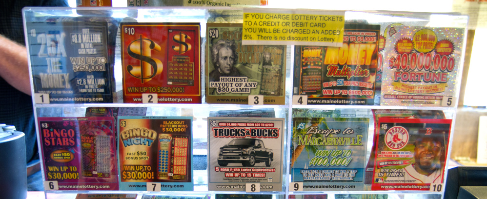 "The flashy designs and ""carnival barking"" of these scratch tickets – on display at the Waite General Store in Washington County – are intended to catch the eye and spur impulse buys."