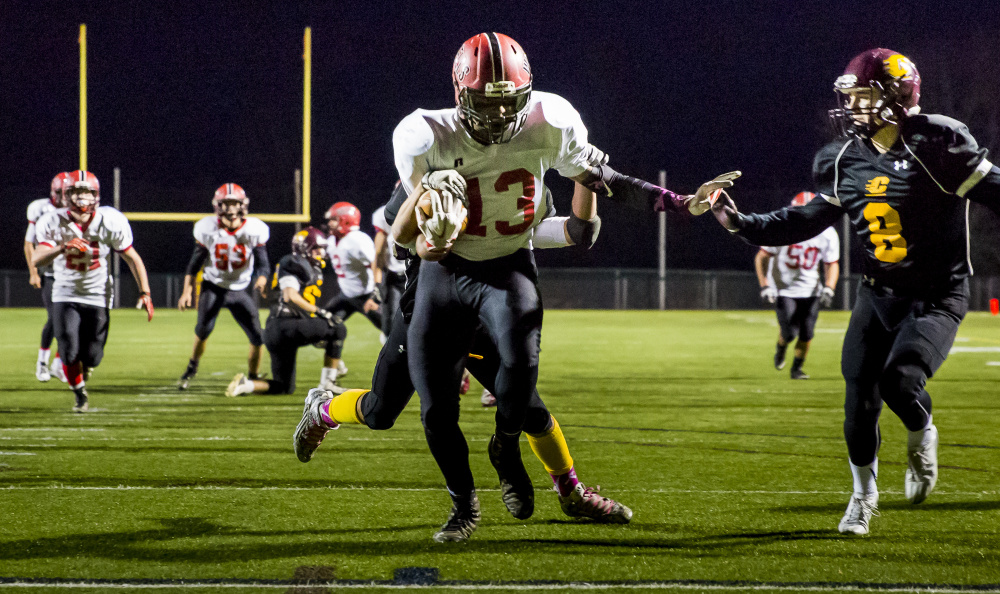 Wells junior Deandre Woods scores the second touchdown of the night Friday during a shutout at Cape Elizabeth. Ben McCanna/Staff Photographer