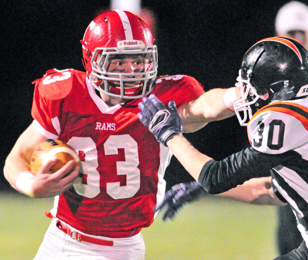 Reid Shostak of Cony keeps Isaiah Swan of Gardiner away Friday night during Cony's 40-0 victory at Augusta.
