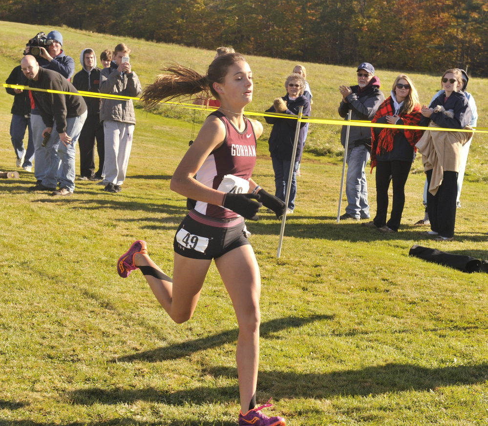Anna Slager of Gorham crosses the finish line to win the Class A South girls' race Saturday at the regional cross country championships, held at Twin Brook Recreation Area in Cumberland.