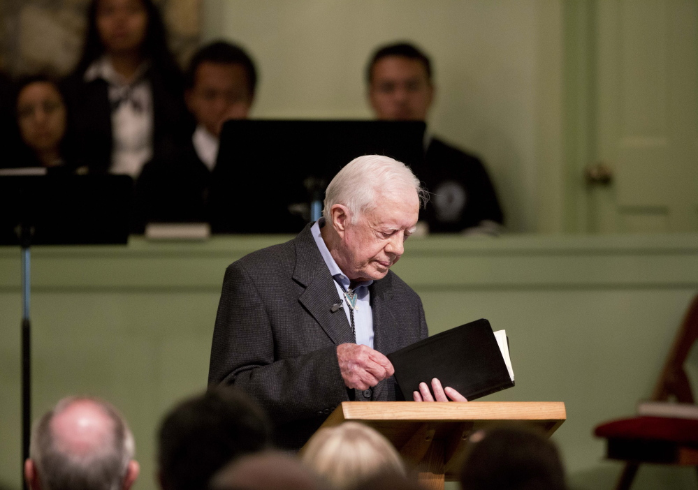 Jimmy Carter teaches Sunday school in his hometown of Plains, Ga. His campaign was funded entirely by public money through a voluntary check-off on IRS Form 1040, making him accountable to the people, a letter writer says.