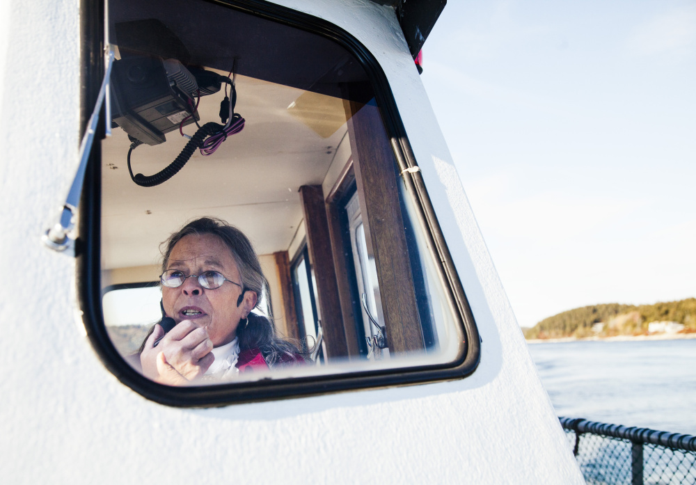 Sally Lobkowicz of Red Cloak Haunted History Tours speaks on the history of the lighthouses along the Kennebec River during the haunted lighthouse tour on Oct. 19. Of seven lighthouses seen on the trip, at least two are thought to be haunted.