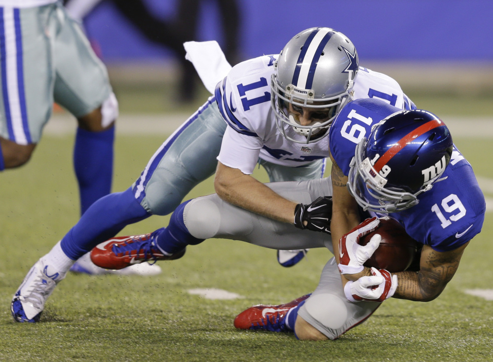 Myles White of the Giants recovers a fumble by Cole Beasley of the Cowboys on a punt return in the second half Sunday in East Rutherford, New Jersey. The Giants won, 27-20.