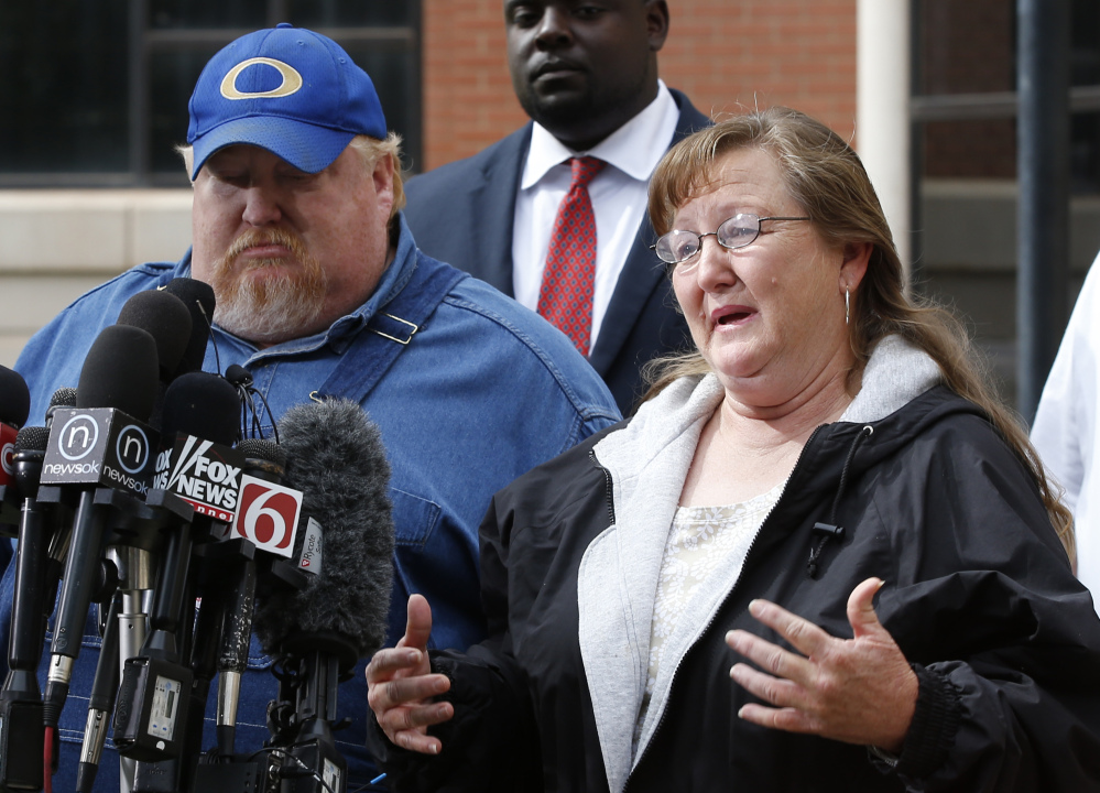 Lynda Branstetter, the aunt of Adacia Chambers, talks with the media outside the courthouse in Stillwater, Okla., on Monday. At left is Floyd Chambers, Adacia's father.