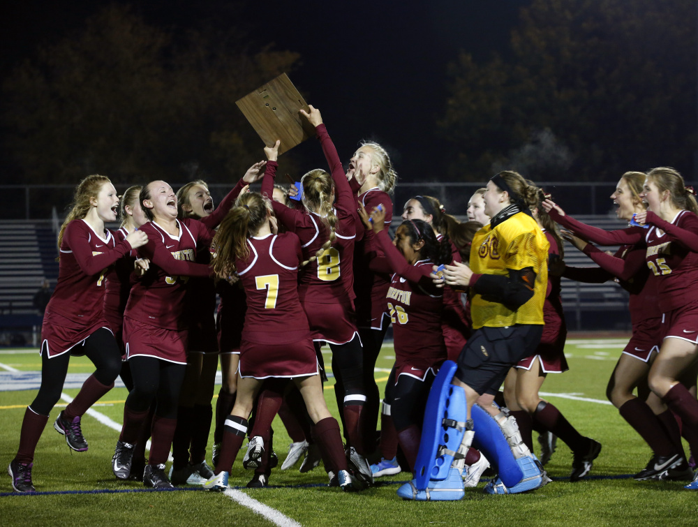 The Thornton Academy field hockey team celebrates its 4-1 win over Cheverus in the Class A South final Tuesday.