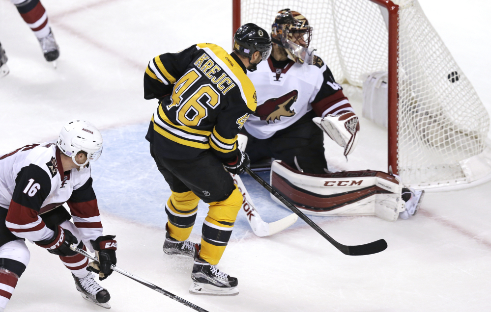 Bruins center David Krejci beats Arizona Coyotes goalie Mike Smith in the third period for his second goal of the game.