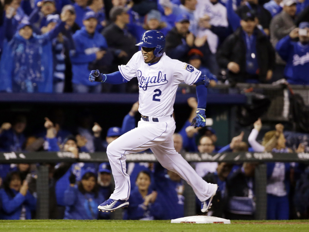 Kansas City's Alcides Escobar rounds the bases on an inside-the-park home run leading off the first inning for the Royals.