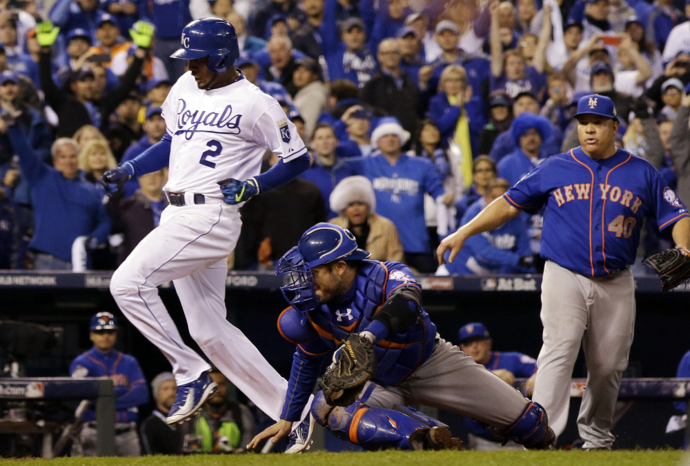 The Royals' Alcides Escobar scores the winning run on a sacrifice fly in the 14th inning of Game 1 of the World Series on Tuesday night. The Royals won, 5-4, to take a 1-0 lead in the series.