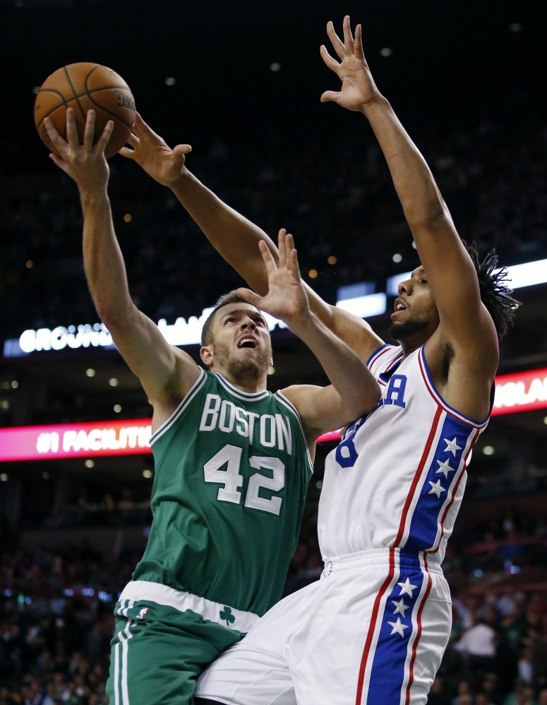 Philadelphia's Jahlil Okafor blocks a shot by the Celtics' David Lee in the first quarter. Okafor led the 76ers with 26 points in the game.