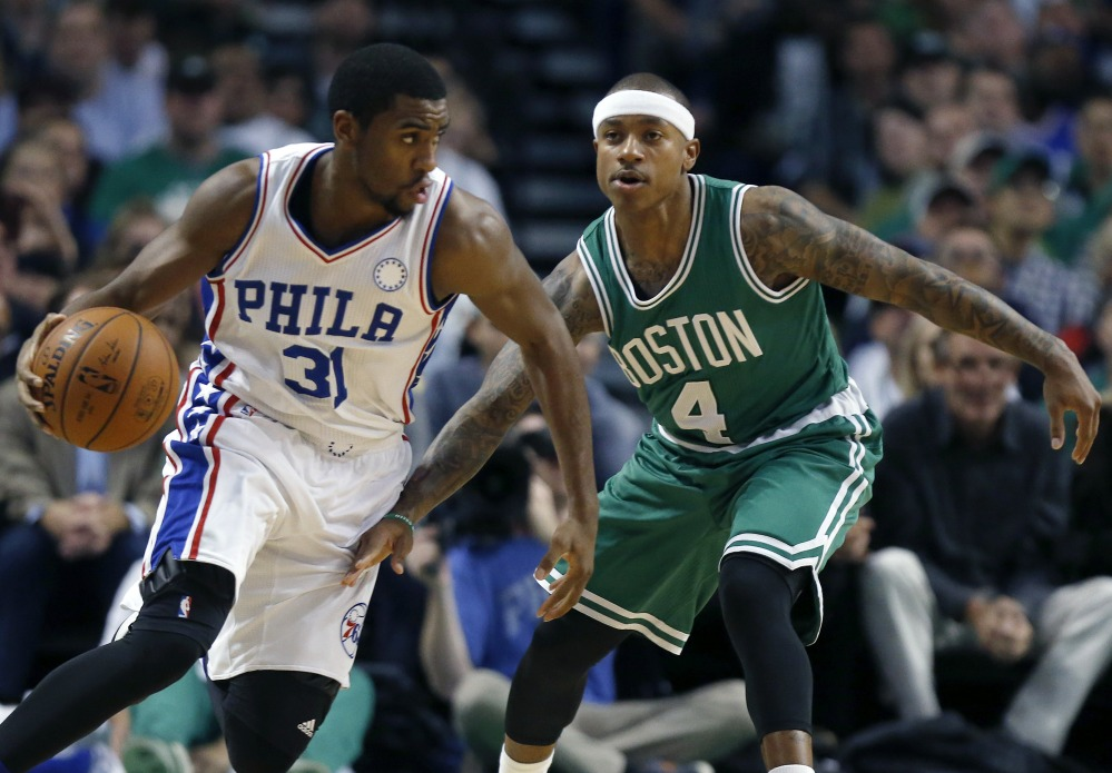 The 76ers' Hollis Thompson drives past Boston's Isaiah Thomas in the second quarter Wednesday night in the Celtics' season opener. The Celtics started 2015-16 with a 112-95 win.