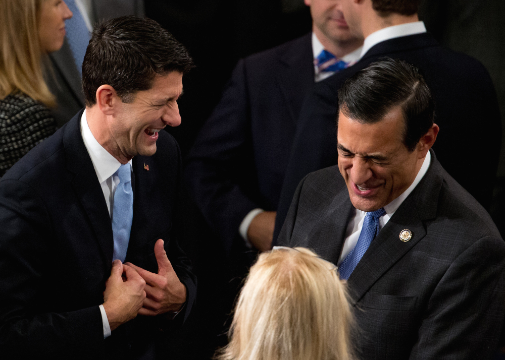 Rep. Paul Ryan, R-Wis., left, shares a laugh with Rep. Darrell Issa, R-Calif., in Washington on Thursday.