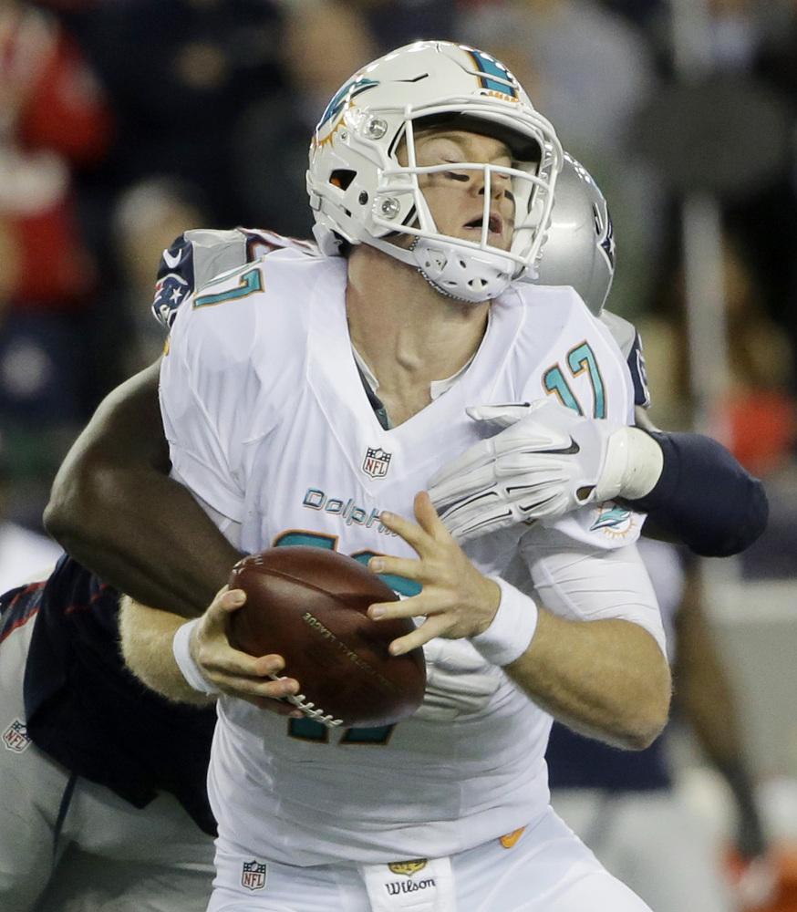 The Patriots defense, including Chandler Jones (95), made it a tough night for Dolphins quarterback Ryan Tannehill.