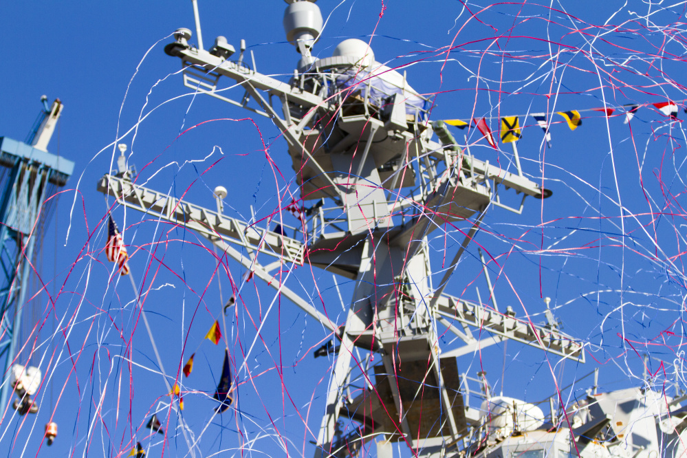 Streamers fly alongside the USS Rafael Peralta after its christening Saturday at Bath Iron Works. Ben McCanna/Staff Photographer