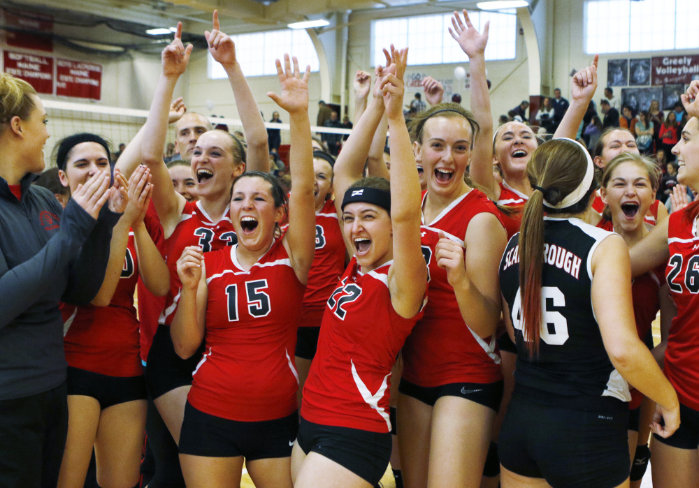 The Scarborough High volleyball team celebrates its victory over Greely in the state Class A final Saturday in South Portland.