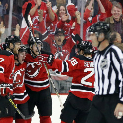Bobby Farnham, second from left, is celebrates his first-period goal with Jon Merrill, left, Sergey Kalinin, center, and Damon Severson during the Devils 3-2 win over the Islanders on Saturday in Newark, New Jersey. The Devils won in a shootout.