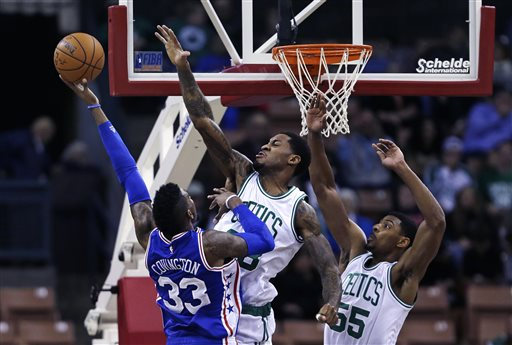Philadelphia 76ers forward Robert Covington is fouled by Boston Celtics forward Perry Jones, center, while driving to the basket in the second half of Friday's preseason game in Manchester, N.H. The Associated Press
