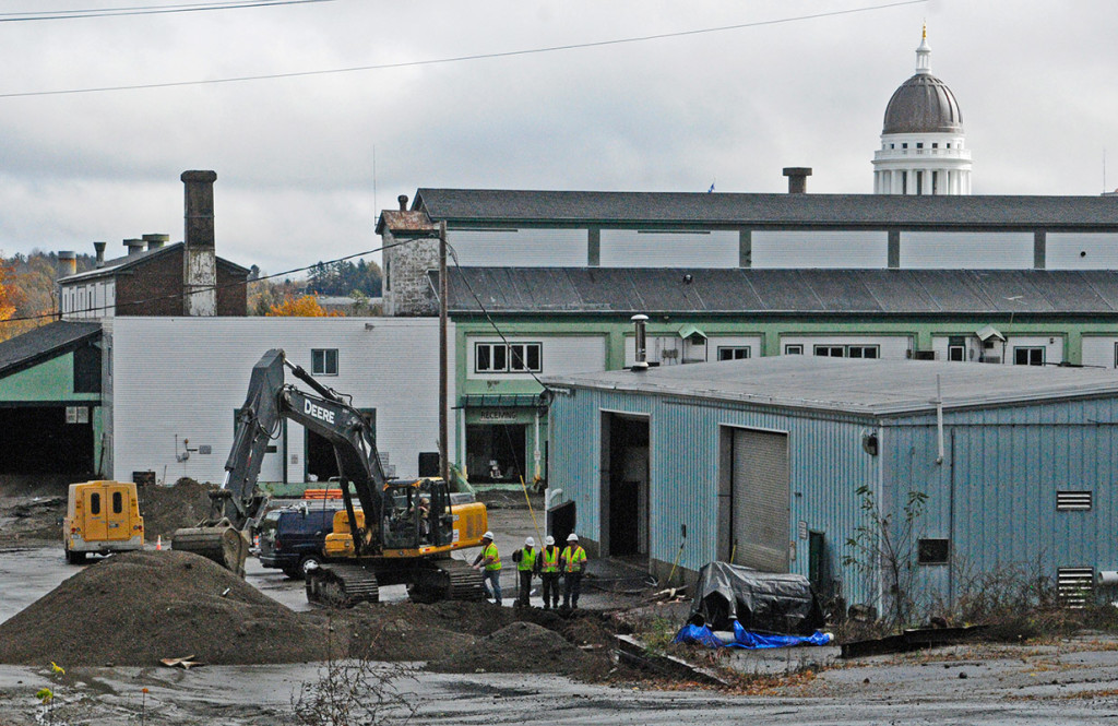 With the State House dome nearby, workers remove old underground fuel tanks from the former Maine Department of Transportation facility in Augusta on Thursday. Joe Phelan/Kennebec Journal