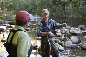 Laura Moorehead, left,speaks with David Miller, right, president of the Sebago chapter of Trout Unlimited, as they fish on the Presumpscot River in Windham.  Joel Page/Staff Photographer