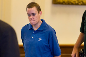 Connor MacCalister, 31, of Saco is led the into courtroom Thursday to plead guilty of murder in the stabbing death of Wendy Boudreau in a supermarket in August. Ben McCanna/Staff Photographer