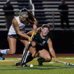 Alana Hartford of Leavitt tries deny a shot by Lilian Posternak of York during the second half of their Class B regional field hockey title game.
