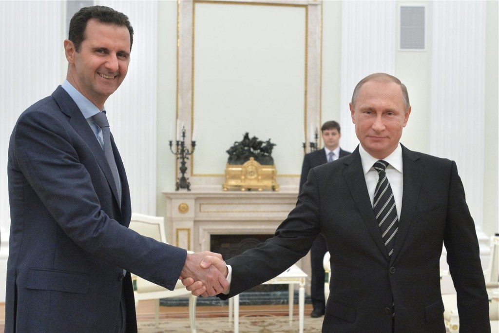 Russian President Vladimir Putin and Syrian President Bashar Assad meet in the Kremlin Tuesday. Assad traveled to Moscow in his first known trip abroad since the war broke out in Syria in 2011. Alexei Druzhinin, RIA-Novosti, Kremlin Pool Photo via AP