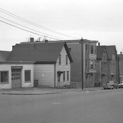 This photograph appeared in the May 12, 1961 edition of the Portland Evening Express as part of a 2-page spread on the proposed Munjoy South urban renewal district. The buildings pictured had been slated for demolition in the city's original urban renewal plan. Ultimately, most of these buildings were spared (as seen in the September 2015 photo) but several nearby blocks were bulldozed to make way for the Munjoy South and Washington Square apartment complexes.
