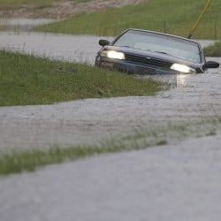 A car is submerged in floodwaters in Florence, S.C., Sunday after steady rain left many roads impassable. The Associated Press