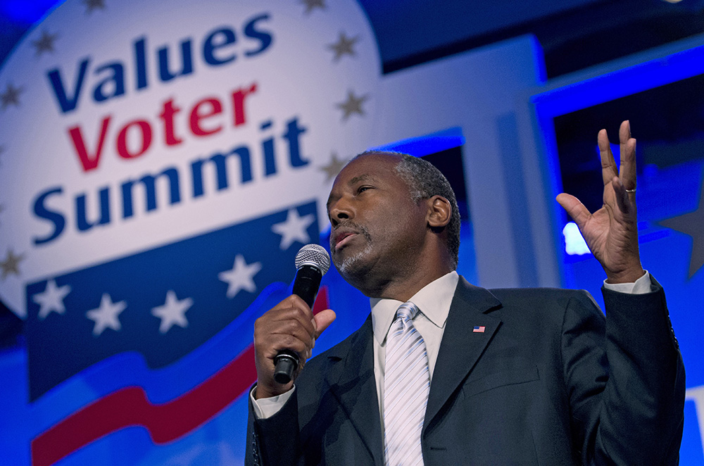 """Republican presidential candidate, retired neurosurgeon Ben Carson speaks during the Values Voter Summit, held by the Family Research Council Action on Sept. 25, 2015, in Washington. Diana West, author of """"American Betrayal: The Secret Assault on Our Nation's Character,"""" says """"now with Dr. Carson ... speaking out, it's drawn more attention because he's a prominent voice on the right. It's drawing mainstream attention."""" The Associated Press"""