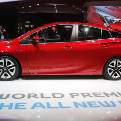 Visitors gather around the new Toyota Prius premiered on the first day of the Frankfurt Auto Show in Frankfurt, Germany. Toyota says the U.S. model will get get 55 mpg in combined city and highway driving, about 10 percent better the current model. The Associated Press