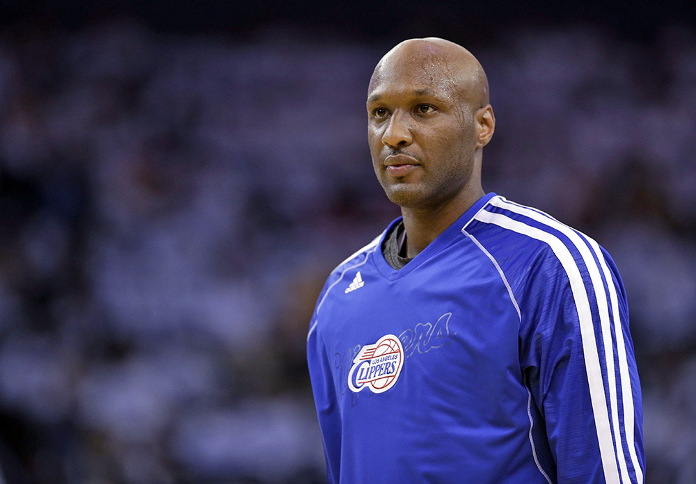 Former Los Angeles Clipper Lamar Odom, pictured in a 2013 game against the Golden State Warriors. The Associated Press