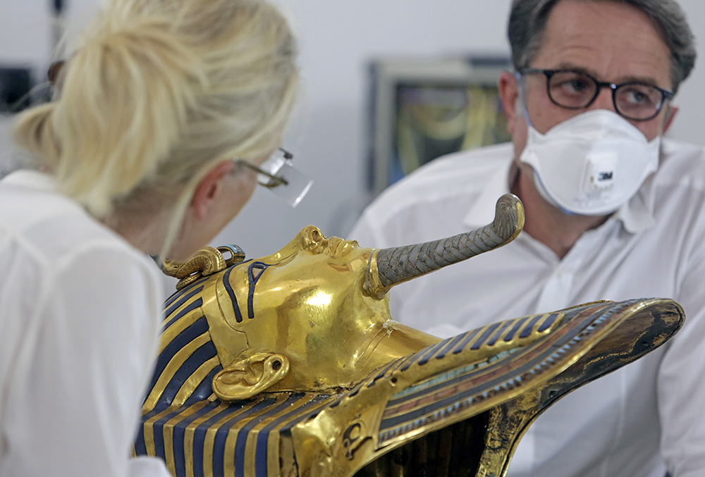 German restorers Christian Eckmann, right, and Katja Broschat examine the golden mask of King Tutankhamun at the Egyptian Museum in Cairo. The 3,300-year-old mask was discovered in Tutankhamun's tomb along with other artifacts by British archaeologists in 1922. The Associated Press