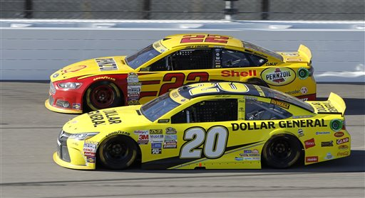 Joey Logano and Matt Kenseth run side-by-side  at Kansas Speedway in Kansas City, Kan., on Sunday. The Associated Press