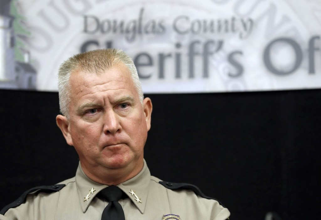 Douglas County Sheriff John Hanlin listens to  a reporter's question during a news conference on Oct. 2 in Roseburg, Ore. Hanlin has become a symbol of the region's rejection of tighter gun control. The Associated Press