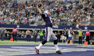 New England Patriots' Tom Brady (12) spikes the ball after scoring on a 1-yard run against the Dallas Cowboys during the first half of an NFL football game, Sunday. The Associated Press