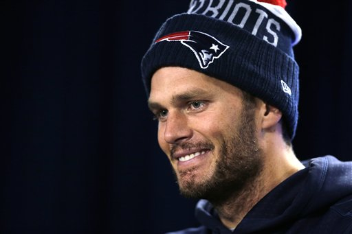 Patriots quarterback Tom Brady listens to a reporter's question during a news conference before Wednesday's practice in Foxborough, Mass. The Associated Press