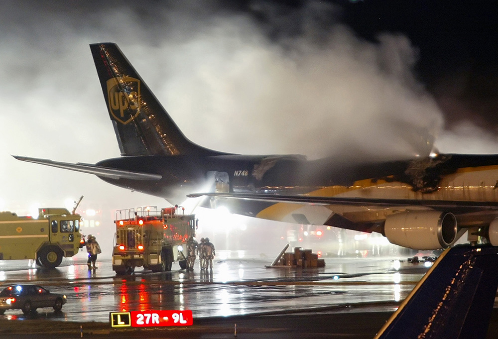 Firefighters battle a blaze onboard a UPS cargo plane at Philadelphia International Airport in this 2008 file photo. The risk of fire is prompting federal officials to back a proposed ban on shiipments of rechargeable lithium-ion batteries as cargo on passenger airlines. The Associated Press