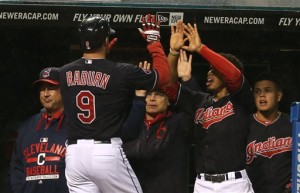 Cleveland Indians' DH Ryan Raburn gets congratulations from teammates after hitting a solo home run against the Boston Red Sox in the fourth inning Saturday  in Cleveland. The Indians won 2-0. The Associated Press