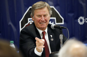 In this Dec. 26, 2014 file photo, South Carolina coach Steve Spurrier gestures during a news conference in Shreveport, La.  A person close to the situation says Spurrier told his team on Monday, Oct. 12, 2015, that he was retiring, effective immediately. The Associated Press