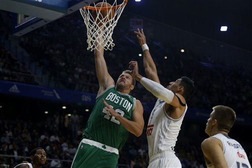 Celtics forward David Lee, left, dunks the ball past Real Madrid's Gustavo Ayon on Thursday at the Barclaycard Centre sport arena in Madrid. The Associated Press