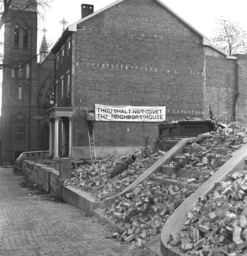 A rooming house tenant protests urban renewal plans near the corner of State Street and Gray Street in December 1970.