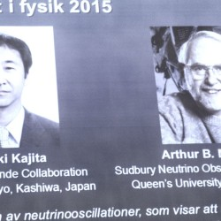 The winners of the Nobel prize in physics are projected on a screen at the Nobel Assembly on Tuesday. The Royal Swedish Academy of Sciences says Takaaki Kajita of Japan and Arthur McDonald won the prize  for their discovery of neutrino oscillations. in which neutrinos change identities. The Associated Press
