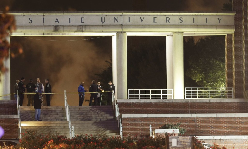 Officials investigate the scene of a shooting on the campus of Tennessee State University, early Friday in Nashville, Tenn. The Associated Press