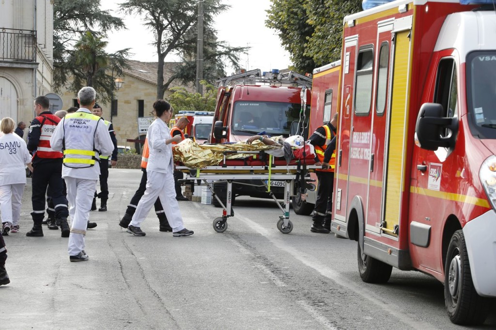 Rescue workers carry an injured person on a stretcher during rescue operations near the site where a tour bus carrying retirees collided with a truck outside Puisseguin near Bordeaux, western France, Friday. Reuters