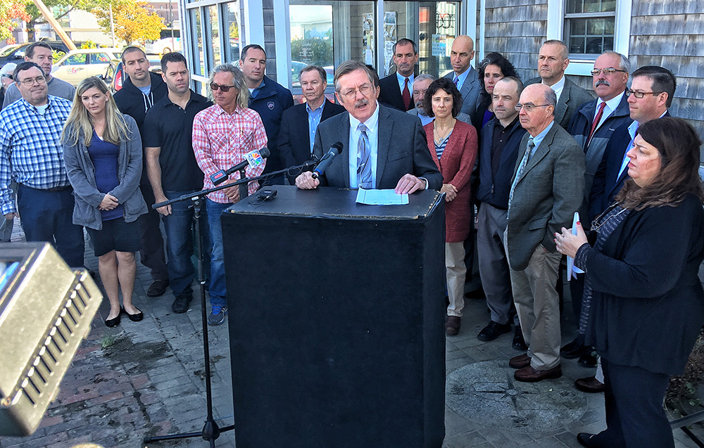 Chris Hall, CEO of the Portland Regional Chamber, speaks Wednesday at a news conference outside Becky's Diner. He asked people to vote no on a referendum that would raise the city's minimum wage to $15 an hour. Gordon Chibroski / Staff Photographer
