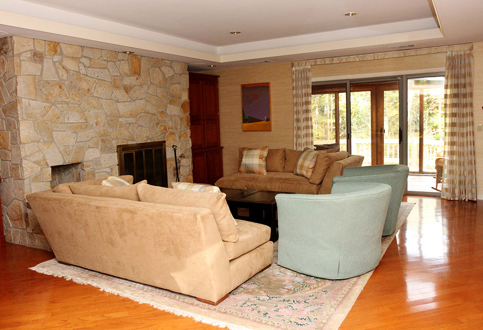 The living room at 35 Buttonwood Lane in Portland before it is staged by The Styled Home.