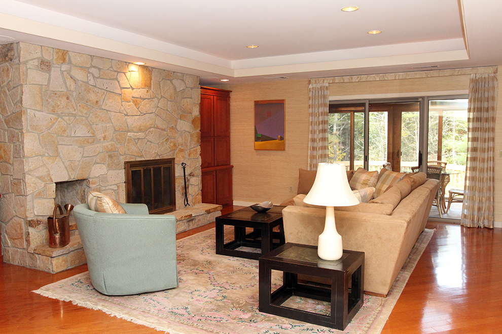 The living room at 35 Buttonwood Lane in Portland after it is staged by The Styled Home using the owner's possessions.