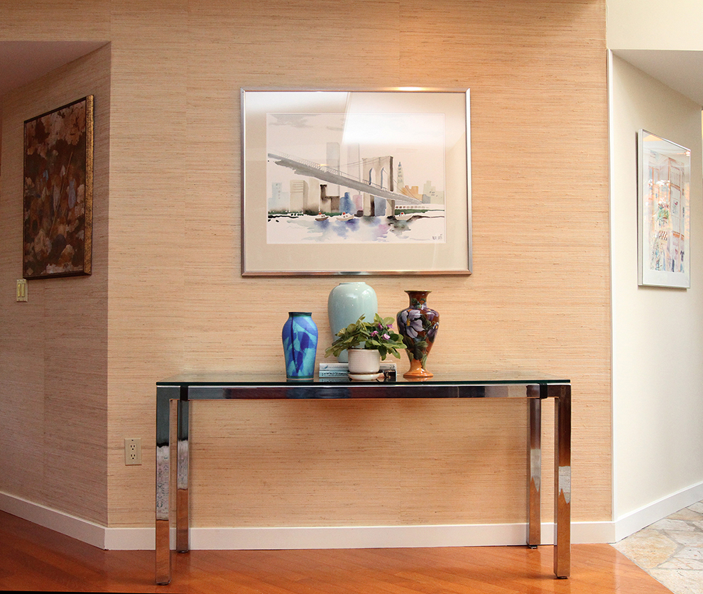 The Styled Home rearranged artwork, vases, and a plant from other areas of the home to make a more pleasing focal area at 35 Buttonwood Lane in Portland.