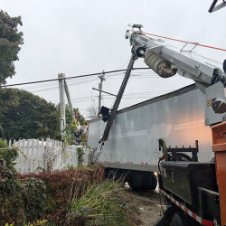 The driver of this tractor-trailer had trouble negotiating the corner of Brighton and Stevens avenues Friday. It was his first day on the job, the driver said.