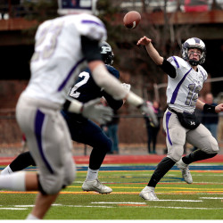 Deering quarterback Max Chabot passes under pressure, looking for Patrick Viola, foreground, in the 104th annual Deering-Portland Thanksgiving Day game. The pass fell incomplete.